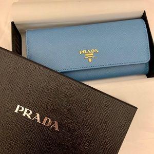 bf5c372bd2a7 Women s Blue Prada Saffiano Wallet on Poshmark